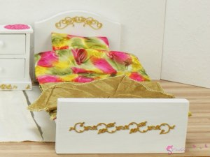 Bed with golden ornaments