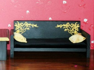 Black sofa with golden ornaments