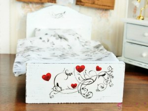 Bed in birds and hearts