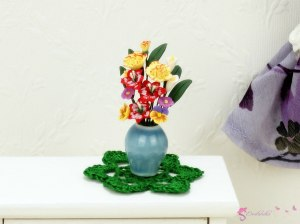 Miniature flowers in a blue vase