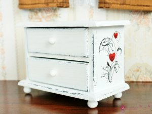 Low chest of drawers in birds and hearts