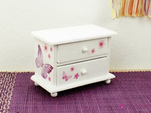 Low chest of drawers with butterflies