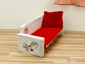 Sofa with birds and hearts