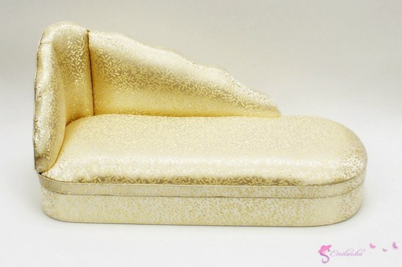 A gold chaise lounge