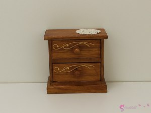 Brown nightstand with gold ornaments