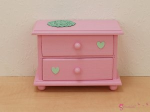 Colorful low chests of drawers with heart