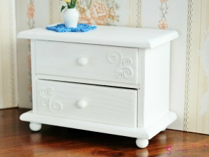 Low chest of drawers with ornaments
